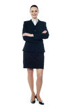 Full length of beautiful businesswoman. Businesswoman posing with folded arms isolated over white, full-length Royalty Free Stock Photography