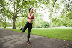 Full length of beautiful fit woman jogging in park Stock Image