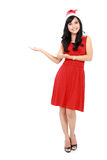 Full length of beautiful woman in christmas santa hat showing co Stock Image