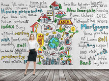 Full length beautiful woman in formal clothes with hands on the waist. Colourful ' home sales ' icons are drawn on the concrete wa. Ll. Risk analysis of the Stock Photos