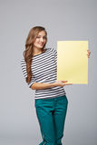 Full length of beautiful woman standing behind, holding white bl Stock Photos