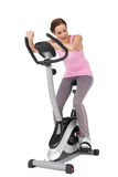 Full length of a beautiful woman on stationary bike Stock Photo
