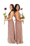 Full length of beautiful women with flowers Royalty Free Stock Photo