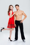 Full length of beautiful young couple standing together Stock Images