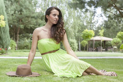 Full length of beautiful young woman in sundress at park Royalty Free Stock Image