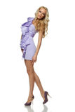 Full length of blond female in lilac dress Royalty Free Stock Photos