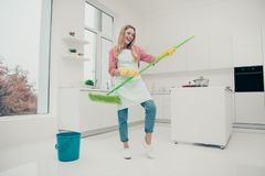 Full length body size photo beautiful nice duties funky she her lady wash white floor pretend rock concert bass royalty free stock photo