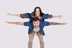 Full length body size photo funky cheer she her he him his lady guy wings pretend piggyback ride walk meet adventures wear casual stock images