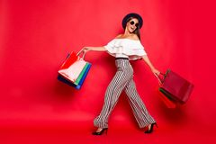 Full length body size portrait of careless carefree trendy styli. Sh elegant chic lady wearing eyeglasses eyewear off-the-shoulders blouse top high heels shoes royalty free stock image