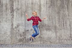 Full length body size portrait of excited cheerful rejoicing pretty style stylish modern worker jumping up wearing red checkered. Shirt denim outfit making royalty free stock photography