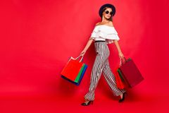 Full length body size portrait of trendy stylish elegant chic la. Dy wearing eyeglasses eyewear off-the-shoulders blouse top high heels shoes with colorful bags royalty free stock photos