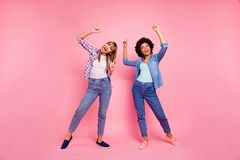 Full length body size view photo two funky diversity she her ladies dancing pop modern rhythms attend hip-hop classes. Wear casual jeans denim checkered shirt royalty free stock photos