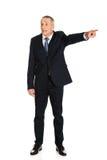 Full length boss dismissing someone.  Stock Photography