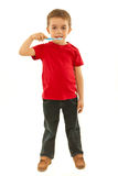 Full length of boy holding toothbrush Stock Images