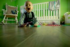 Full Length of Boy Sitting on Floor Stock Photo