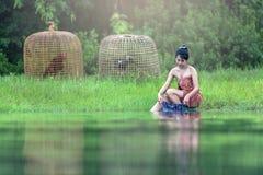 Full Length of Boy Sitting on Grass Stock Images
