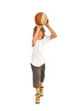Full length of boy throwing basketball Stock Photography