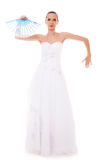 Full length bride in wedding gown holds fan isolated Royalty Free Stock Photos