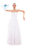 Full length bride in wedding gown holds fan isolated Stock Photos