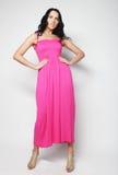 Full length of brunette female in pink dress posing Royalty Free Stock Images