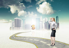 Full length business lady is standing on the way to the new perspectives in the huge city financial market. Royalty Free Stock Image