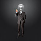 Full length business male with lamp-head Stock Photos