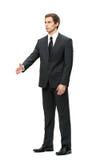 Full length of business man handshake gesturing Stock Photo