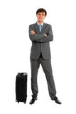 Full length of business man standing near luggage. Isolated on white background Stock Images