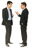 Full length of business men conversation. Full length of two business men having conversation together isolated on white background Stock Photo