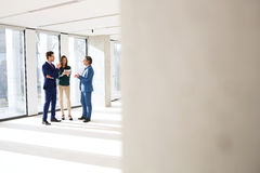 Full length of business people discussing in new office Stock Image