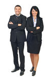 Full length of business people team. Full length of happy business people team standing with hands crossed isolated on white background royalty free stock photo