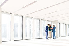 Full length of business people using digital tablet in new office Stock Images