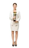 Full length of business woman with cup Royalty Free Stock Photography