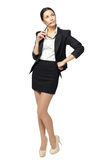 Full length of business woman looking up Stock Photography