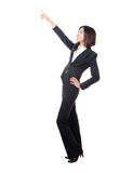 Full length of business woman point something Stock Photos