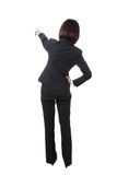 Full length Business woman points finger in back Royalty Free Stock Photo