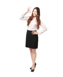 Full length of business woman showing OK hand sign Stock Image