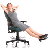 Full length business woman sitting on chair is Stock Images