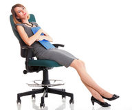 Full length business woman sitting on chair holding clipboard is Stock Images