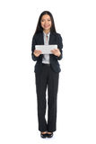 Full length business woman smiling Stock Photo
