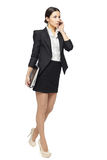 Full length of business woman talking on the phone Stock Photography