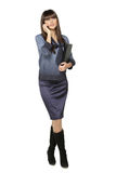 Full length of business woman talking on the phone Stock Images