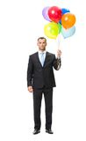 Full length of businessman with balloons. Full-length portrait of businessman with colourful balloons, isolated on white Stock Photography