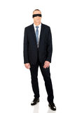 Full length businessman with band on eyes Stock Images