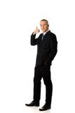 Full length businessman with call me gesture Royalty Free Stock Photography