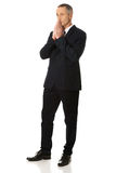 Full length businessman with clenched hands Stock Photo