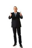 Full length businessman gesturing ok sign Stock Photography