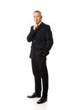Full length businessman gesturing silent sign Royalty Free Stock Images