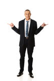 Full length businessman with hands on both sides Stock Photos