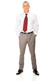 Full length businessman with hands in pockets Stock Photos